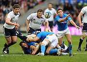 Italy scrum half Fabio Semenzato gets his pass away as Ross Ford closes in.<br /> Scotland v Italy, Six Nations Championship, Murrayfield, Edinburgh, Scotland, Saturday 19th March 2010.<br /> Please credit ***FOTOSPORT/DAVID GIBSON***