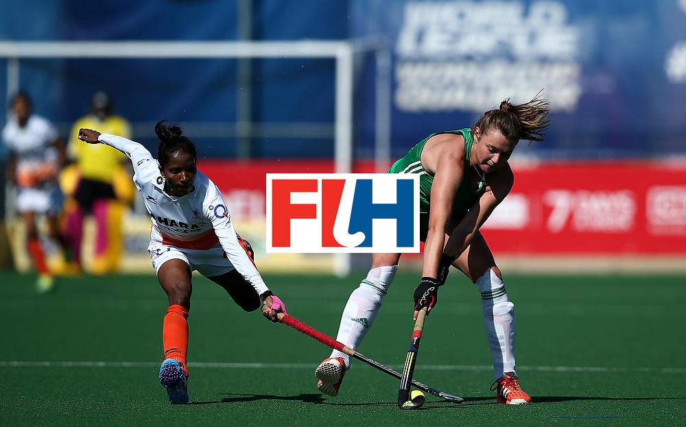 JOHANNESBURG, SOUTH AFRICA - JULY 22:  Deirdre Duke of Ireland battles with Nikki Pradhan of India during day 8 of the FIH Hockey World League Women's Semi Finals 7th/ 8th place match between India and Ireland at Wits University on July 22, 2017 in Johannesburg, South Africa.  (Photo by Jan Kruger/Getty Images for FIH)