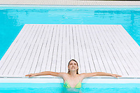 Young Woman relaxing in Swimming Pool high angle view