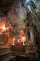 Mandarin statues guard the entrance to the Huyen Khong Cave on Nhuyen Son Mountain, Da Nang, Vietnam