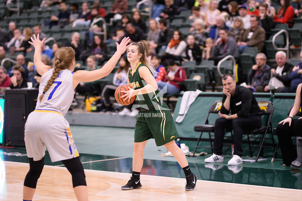 4th year guard Britton Belyk (11) of the Regina Cougars during the Women's Basketball home game on November 25 at Centre for Kinesiology, Health and Sport. Credit: Casey Marshall/Arthur Images