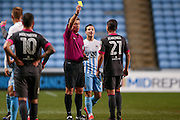 Tonights referee Mark Haywood  Morecambe  defender, on loan from Cheltenham town, James Jennings (21) is booked and receives a caution and a yellow card during the The FA Cup match between Coventry City and Morecambe at the Ricoh Arena, Coventry, England on 15 November 2016. Photo by Simon Davies.