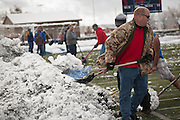 Volunteers shovel snow from the field before the Utah High School 2A Football championship game between San Juan and Manti in Pleasant Grove, Saturday, Nov. 10, 2012.
