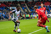 Joe Dodoo of Bolton Wanderers on the attack during the EFL Sky Bet League 1 match between Bolton Wanderers and Milton Keynes Dons at the University of  Bolton Stadium, Bolton, England on 16 November 2019.
