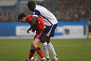 Ian Henderson held by Moussa Diarra during the The FA Cup 3rd round match between Barrow and Rochdale at Holker Street, Barrow, United Kingdom on 7 January 2017. Photo by Daniel Youngs.