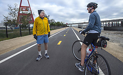 March 22, 2019 - Anaheim, California, U.S. - Jim Smith, 82, left, a retired Orange County superior court judge, stops to talk with Scott Weitzman while out for a morning run along the Santa Ana River Trail in Anaheim on Friday, March 22, 2019. Smith is a Los Angeles Marathon Legacy Runner who has completed every Los Angeles Marathon since the first race in 1986. (Credit Image: © Mark Rightmire/SCNG via ZUMA Wire)