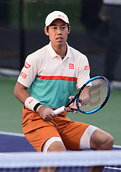 March 8, 2019 - Indian Wells, CA, U.S. - INDIAN WELLS, CA - MARCH 08: Kei Nishikori (JPN) plays near the net in the first set of a doubles match during the BNP Paribas Open played at the Indian Wells Tennis Garden in Indian Wells, CA. (Photo by John Cordes/Icon Sportswire) (Credit Image: © John Cordes/Icon SMI via ZUMA Press)