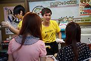 Tokyo, September 18 2011 - Two young Korean preparing Korean food. Korean mania reached Tokyo's Korean neighborhood near Shinokubo station. For a long time Japanese ladies in their 50ies have been interested in Korean televised dramas. Recently the success of K-Pop (Korean popular music) in Japan has brought a younger population in the neighborhood.
