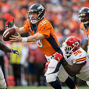 Denver Broncos quarterback Peyton Manning (18) fumbled the football in the first quarter after a hit by Kansas City Chiefs nose tackle Jaye Howard (96) on Sunday, November 15, 2015 at Sports Authority Field in Denver, Co. The Broncos recovered the fumble.