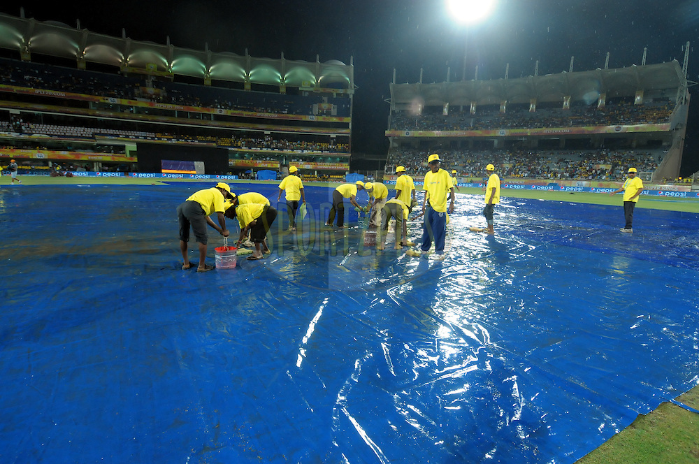 Ground staff coverd the ground during rain  match 21 of the Pepsi Indian Premier League Season 2014 between the Chennai Superkings and the Kolkata Knight Riders  held at the JSCA International Cricket Stadium, Ranch, India on the 2nd May  2014<br /> <br /> Photo by Arjun Panwar / IPL / SPORTZPICS<br /> <br /> <br /> <br /> Image use subject to terms and conditions which can be found here:  http://sportzpics.photoshelter.com/gallery/Pepsi-IPL-Image-terms-and-conditions/G00004VW1IVJ.gB0/C0000TScjhBM6ikg