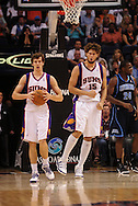 Mar. 19 2010; Phoenix, AZ, USA; Phoenix Suns guard Goran Dragic (2) and center Robin Lopez (15) react during the first half at the US Airways Center.  The Suns defeated the Jazz 110-100. Mandatory Credit: Jennifer Stewart-US PRESSWIRE.