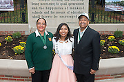 Ohio University President, Roderick McDavis, and Ohio University First Lady, Deborah McDavis, pose with Alexis Apparacio, a member of Ohio University's Homecoming Court, at the College Gateway on October 8, 2016.