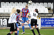 Steph Mann heading clear the danger during the FA Women's Premier League match between Crystal Palace LFC and Bedford Ladies at Bromley Football Club, Bromley, Kent, United Kingdom on 15 March 2015. Photo by Michael Hulf.