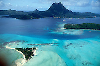 French Polynesia, Islands in the South Pacific, part of the French overseas Territories.Photo by Owen FrankenFrench Polynesia, Islands in the South Pacific, part of the French overseas Territories..Bora Bora..Photo by Owen FrankenFrench Polynesia, Islands in the South Pacific, part of the French overseas Territories..aerial view of Bora Bora, with Motos (little islands)...Photo by Owen Franken
