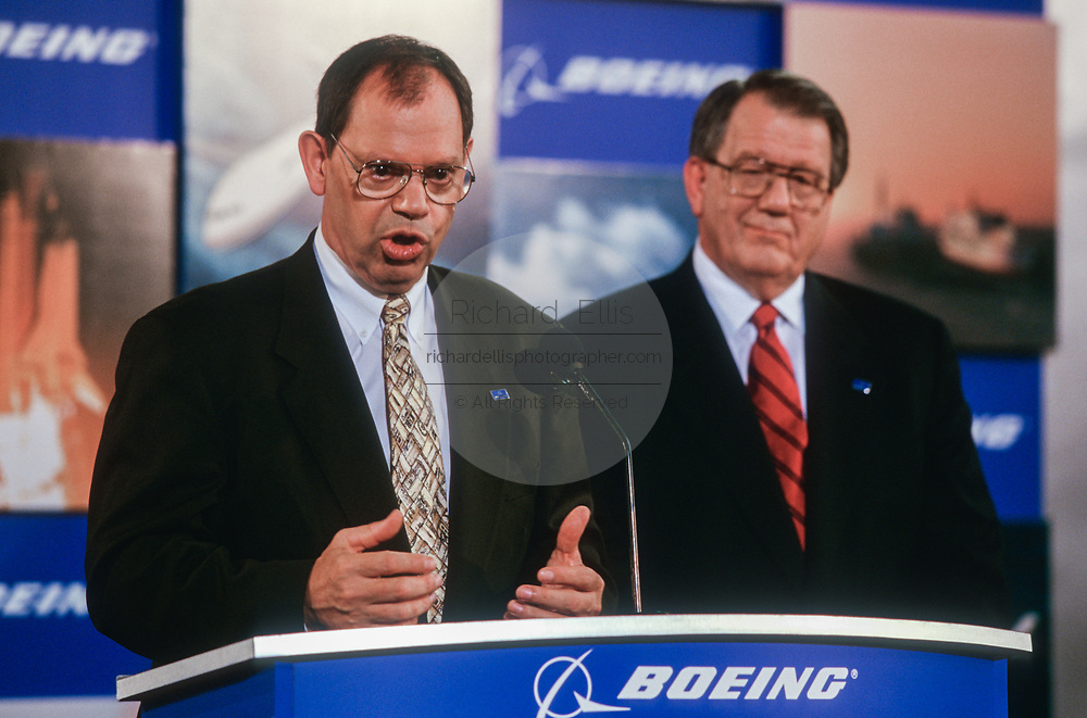 WASHINGTON, DC, USA - 1997/08/04: Boeing CEO Philip Condit, left, and McDonald Douglas CEO Harry Stonecipher during the announcement of details on their merger at the Smithsonian's National Air & Space Museum August 4, 1997 in Washington, DC.  (Photo by Richard Ellis)