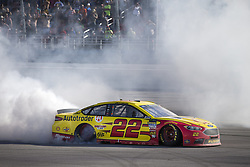 April 29, 2018 - Talladega, Alabama, United States of America - Joey Logano (22) takes the checkered flag and wins the GEICO 500 at Talladega Superspeedway in Talladega, Alabama. (Credit Image: © Justin R. Noe Asp Inc/ASP via ZUMA Wire)