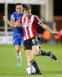 Peterborough United's Paul Taylor in action with Brentford's Tony Craig - Photo mandatory by-line: Joe Dent/JMP - Tel: Mobile: 07966 386802 08/10/2013 - SPORT - FOOTBALL - London Road Stadium - Peterborough - Peterborough United V Brentford - Johnstone's Paint Trophy
