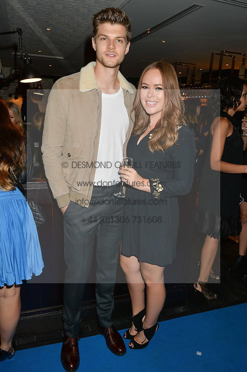 TANYA BURR and JIM CHAPMAN at the Maybelline New York: Party, part of the London Fashion Week Spring Summer 15 held at Tredwell's, 4a Upper St Martins Lane, London on 12th September 2014.