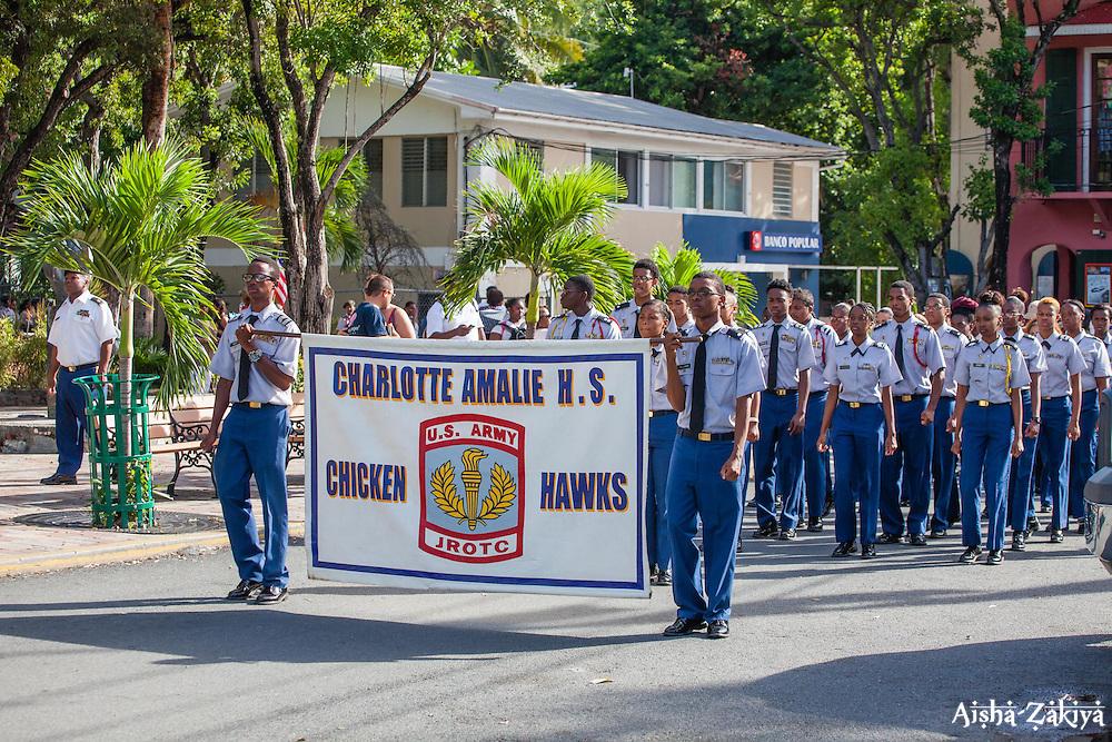 Charlotte Amalie High School JROTC marches through Cruz Bay.  St. John Veterans Day Parade in Cruz Bay.  Frank Powell Park.  St. John, USVI.  8 November 2015.  © Aisha-Zakiya Boyd