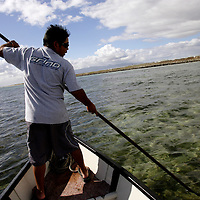 HONOLULU, HAWAII, November 8, 2007: Tadd Fujikawa, a sixteen-year-old professional golfer, fishes for octopus off the coast of Honolulu, Hawaii. (Photographs by Todd Bigelow/Aurora)