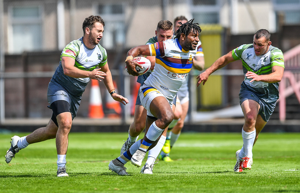Whitehavens' Jesse Joe Nandye evades the tackle of West Wales Raiders' Archie Snook<br /> <br /> Photographer Craig Thomas/Replay Images<br /> <br /> Betfred League 1 - West Wales Raiders v Whitehaven  - Saturday 23rd June 2018 - Stebonheath Park - Llanelli<br /> <br /> World Copyright © 2017 Replay Images. All rights reserved. info@replayimages.co.uk - www.replayimages.co.uk