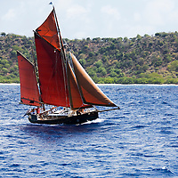 An unidentified traditional Gaff rigged schooner sailing off the coast of Antigua during the 2008 Antigua Classic Yacht Regatta . This race is one of the worlds most prestigious traditional yacht races. It takes place annually off the costa of Antigua in the British West Indies.