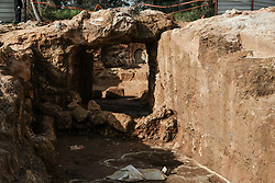 March 27, 2019 - Jerusalem, Israel - A 2000 year old Hasmonean period, 2nd temple era, Jewish village of agricultural nature, has been uncovered in excavations conducted in the Sharafat neighborhood of Jerusalem. Excavations have yielded remains of a large wine press containing fragments of many storage jars, a large columbarium cave (rock cut dovecote), an olive press, a large ritual bath (mikveh), a water cistern, rock quarries and installations. The most significant find is an extravagant burial estate, which included a corridor leading to a large courtyard chiseled into the bedrock. The burial cave, which included several chambers, each with oblong burial niches chiseled into the walls, has been sealed in accordance with Orthodox Jewish requirements. (Credit Image: © Nir Alon/ZUMA Wire)