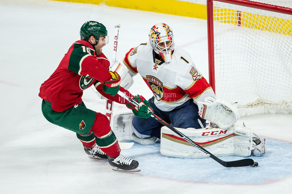 Dec 13, 2016; Saint Paul, MN, USA; Minnesota Wild forward Jason Zucker (16) scores a goal on Florida Panthers goalie Roberto Luongo (1) during the third period at Xcel Energy Center. The Wild defeated the Panthers 5-1. Mandatory Credit: Brace Hemmelgarn-USA TODAY Sports
