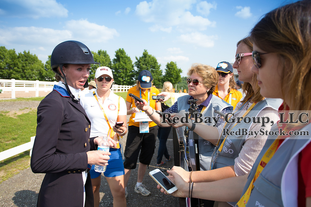Laura Graves (USA) speaks with the International press at the OLG Caledon Pan Am Equestrian Park during the Toronto 2015 Pan American Games in Caledon, Ontario, Canada.