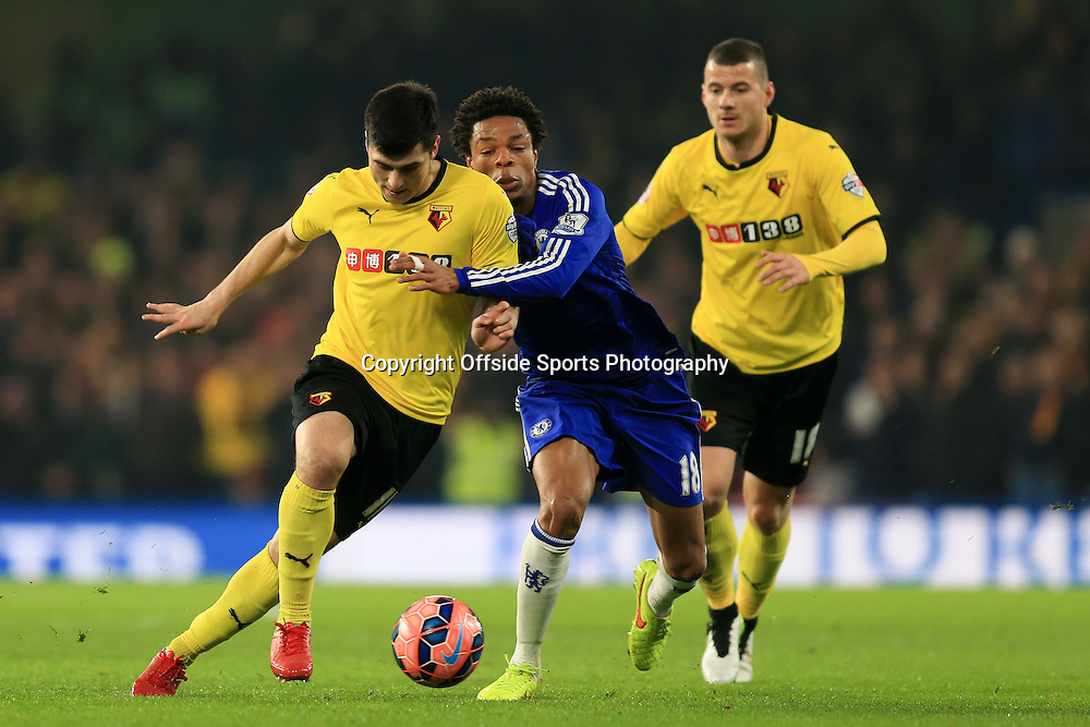 4 January 2015 - The FA Cup 3rd Round - Chelsea v Watford - Loic Remy of Chelsea tangles with Fernando Forestieri and Daniel Pudil of Watford - Photo: Marc Atkins / Offside.