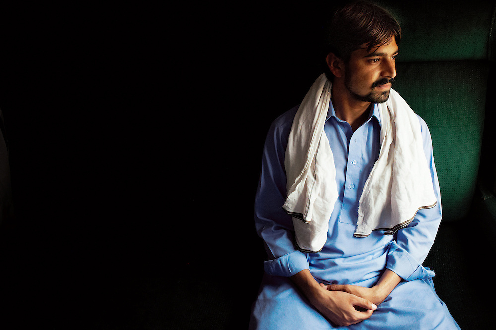 Pakistan Railway Clerk Mohammad Ishtiaq, 19years old sits on the Khyber Mail traveling from Karachi to Peshawar on August 19, 2011. He has worked for 2 months for Pakistan Railways. He has five siblings.