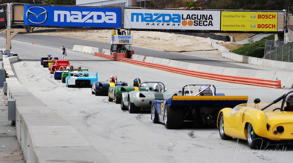 SCCA racing participants line up on the starting grid of Laguna Seca Raceway, Monterey