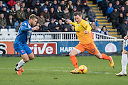 Garry Thompson (Midfielder) of Wycombe Wanderers shoots at goal whilst being watched by Hartlepool United midfielder Jordan Richards the Sky Bet League 2 match between Hartlepool United and Wycombe Wanderers at Victoria Park, Hartlepool, England on 16 January 2016. Photo by George Ledger.