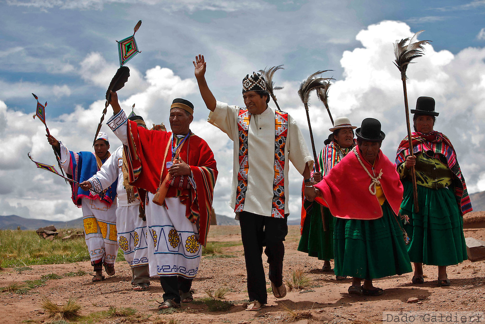 Bolivia's President Evo Morales, center, waves as he is escorted by shamans during an indigenous religious ceremony that recognizes Morales as the country's leader in Tiwanaku, Bolivia, Thursday, Jan. 21, 2010.  Morales won general elections in December with 64% of the votes and his official inauguration is scheduled for Friday.