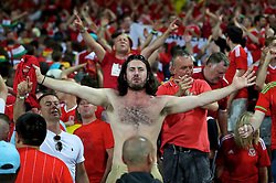 TOULOUSE, FRANCE - Monday, June 20, 2016: Wales supporters celebrate the 3-0 victory over Russia and reaching the knock-out stage during the final Group B UEFA Euro 2016 Championship match at Stadium de Toulouse. (Pic by David Rawcliffe/Propaganda)