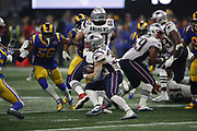 New England Patriots running back Rex Burkhead (34) in action during the NFL Super Bowl 53 football game against the Los Angeles Rams on Sunday, Feb. 3, 2019, in Atlanta. The Patriots defeated the Rams 13-3. (©Paul Anthony Spinelli)