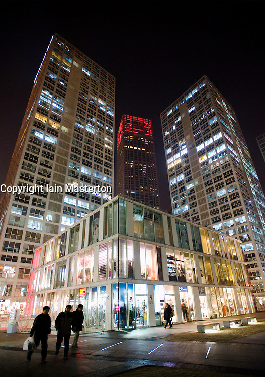 Night view of skyscrapers and shops in new modern SoHo property development in CBD district of Beijing China