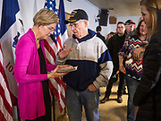 16 DECEMBER 2019 - KEOKUK, IOWA: US Senator ELIZABETH WARREN (D-MA) talks to a Vietnam veteran during a campaign event in Keokuk, IA, Monday. About 100 people attended the town hall. Warren is campaigning in southeastern Iowa this weekend to support her effort to be the Democratic nominee for the US presidential race in 2020. This was Warren's 185th town hall, and 88th event in Iowa. Iowa traditionally hosts the first presidential selection event of the campaign season. The Iowa caucuses are Feb. 3, 2020.     PHOTO BY JACK KURTZ