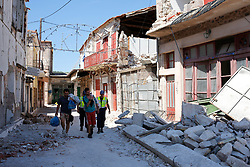 June 13, 2017 - Vrissa-Lesvos Island, Greece - People carry their belongings amidst the rubble of collapsed houses in the village of Vrissas, following a strong earthquake struck Lesvos island, in Greece, 12 June 2017. Rescue workers reached the body of 45-year-old woman trapped under the rubble of a fallen house in Vrisa, Lesvos following 12 June's earthquake but she was already dead, authorities reported. A 6.3- magnitude earthquake struck with it's epicentre near the coast of Greek island Lesbos (Credit Image: © Eurokinissi via ZUMA Wire)