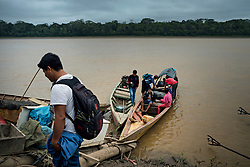 NO WEB/NO APPS - Exclusive. (Text available) Every Monday morning, high school students from the 'Palma Real' native community are transported aboard a canoe to Puerto Maldonado where they will take the lessons and then come back to the community for the weekend, in 'Palma Real' native community, near Puerto Maldonado, Peru on July 17, 2017. The Amazon rainforest is famous as 'The Lung of the Earth', but also for the presence of numerous native communities, who have always lived isolated and in close contact with nature for generations, used to seek for food and medicines and to build items directly from the environment in which they live. The unstoppable rise of globalization has drastically changed their needs, expectations and consequently their way of life. Located in the Tambopata National Reserve, on the border between Peru and Bolivia, the native Comunidad Palma Real is one of the clearest examples of this change. Living on the banks of the Madre de Dios River since approximately 1976, Palma Real comprises about 300 people part of the nomadic community Ese-Eja, established in the Amazon rainforest of Peru before the Spanish colonization. Photo by Giacomo d'Orlando/ABACAPRESS.COM