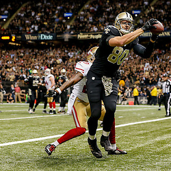 Nov 9, 2014; New Orleans, LA, USA; New Orleans Saints tight end Jimmy Graham (80) catches a touchdown over San Francisco 49ers cornerback Perrish Cox (20) during the fourth quarter of a game at Mercedes-Benz Superdome. Mandatory Credit: Derick E. Hingle-USA TODAY Sports
