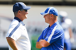 September 17, 2011; San Francisco, CA, USA;  California Golden Bears head coach Jeff Tedford (left) talks to Presbyterian Blue Hose head coach Harold Nichols (right) before the game at AT&T Park.