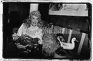 "April 1991:  Actress Donna Douglas, best  known for portraying Ellie May Clampett on ""The Beverly Hillbillies"" TV show poses for a photos with some live chickens at a part at the Limelight nightclub in New York City."