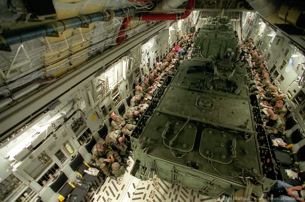 Comfortably packed into the fuselage of an Air Force C-17 two Strykers and their infantry squads fly from Ft. Lewis, Wash., to the National Training Center in Ft. Irwin, Calif. on Thursday, July 25, 2002. The army has only had the Stryker for a month and this is their debut in maneuvers at 'war' at Ft. Irwin for the Millennium Challenge 2002 Experiment (MCO2)...The Stryker has a communictions package, called the FBCB2 that enables them to transmit and receive data on their position, the position of other FBCB2 equiped vehicles, still shots from unmanned aerial vehicles, and data from higher command. This will help improve their intelligence knowledge and share in real time with other units...As part of the military transformation MC02 is testing all branches of the military in the largest ever live and virtual battle being played out across the nation through August 15, 2002. The goal is to see how well the different branches operate together under a joint command that shares intelligence and resources in an effort to put the right forces in the right place at the right so as to minimze the amount of fighting that is necessary to protect U.S. interests abroad.