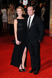 Jean Dujardin and wife Alexandra Lamy arrive for the 2012 ORANGE BRITISH ACADEMY FILM AWARDS, The Bafta's at The Royal Opera House, Covent Garden, London. Photo By I-Images