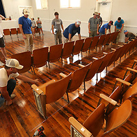 Workers with Sullivan Enterprises out of Magee Mississippi, set a chalk line to mark the correct spot for a row of seats being reinstalled in the auditorium at Lawhon Elementary School on Thursday morning.