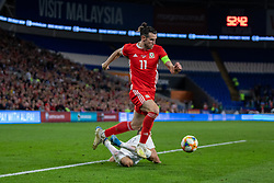 CARDIFF, WALES - Friday, September 6, 2019: Wales' captain Gareth Bale gets away from Azerbaijan's Anton Krivotsyuk during the UEFA Euro 2020 Qualifying Group E match between Wales and Azerbaijan at the Cardiff City Stadium. (Pic by Mark Hawkins/Propaganda)