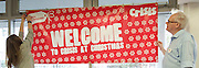 Crisis at Christmas, London, Great Britain <br /> 23rd December 2016 <br /> <br /> volunteers put up a welcome sign at the centre <br /> <br /> First day of operations at one of the Crisis centres in London.<br /> <br /> Crisis at Christmas is a lifeline for thousands of homeless people across the UK, offering support, companionship and vital services over the festive period.<br />  <br /> Crisis at Christmas provides immediate help for homeless people at a critical time - one in four homeless people spends Christmas alone - but our work does not end there. We encourage guests to take up the life-changing opportunities on offer all year round at our centres across the country. <br />  <br /> Crisis is the national charity for homeless people.<br /> <br /> Crisis reveals scale of violence and abuse against rough sleepers as charity opens its doors for Christmas<br /> <br /> People sleeping on the street are almost 17 times more likely to have been victims of violence and 15 times more likely to have suffered verbal abuse in the past year compared to the general public, according to new research from Crisis, the national charity for homeless people.<br />  <br /> <br /> Photograph by Elliott Franks <br /> Image licensed to Elliott Franks Photography Services