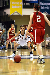 20 March 2010: Liz Ellis readies to defend Alex Hoover. The Flying Dutch of Hope College fall to the Bears of Washington University 65-59 in the Championship Game of the Division 3 Women's NCAA Basketball Championship the at the Shirk Center at Illinois Wesleyan in Bloomington Illinois.