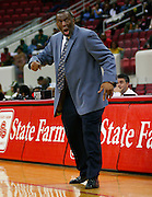 "Coppin State men's basketball team head coach Ronald ""Fang"" Mitchell reacts to a call during the 2006 MEAC Basketball Tournament at the RBC Center in Raleigh, North Carolina.  March 08, 2006  (Photo by Mark W. Sutton)"